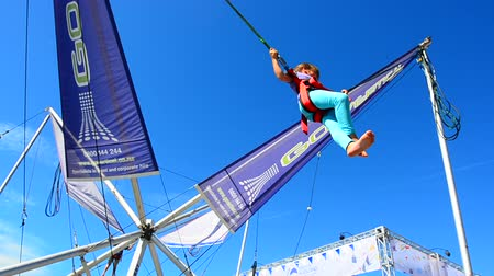 adrenalin : AUCKLAND - JAN 30 2016: Little girl Talya Ben-Ari age 5-6 jumps on Bungee trampoline.Its a mechanical amusement attraction which contains a support structure and pulley system with bungee cords. Dostupné videozáznamy