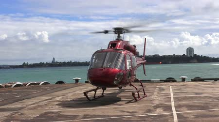 pilóta : AUCKLAND - JAN 31 2016:Helicopter taking off from landing pad.Helipad provides a clearly marked hard surface where a helicopter can land safely.