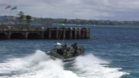 zodiak : AUCKLAND, NZL - JAN 30 2016:Royal New Zealand navy sailors ride a Zodiak Rigid-hulled inflatable boat in ports of Auckland.The RNZN has a role to help prevent any unrest occurring in New Zealand.