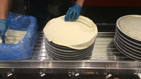 nzl : AUCKLAND, NZL - JAN 31 2016:Chef hands preparing pizza base.Pizza is a 30 billion per year industry.Approximately 3 billion pizzas are sold in the U.S. each year.