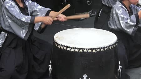 taiko drumming : Street performance of Taiko drumming on Japanese drums.Taiko were used in Japan since the 6th century CE, for communication, in festivals, religion ceremonies and other rituals.