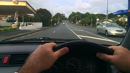 pontos : Timelapse steering wheel point of view driving in Karangahape Road, one of the most popular and main streets in the central business district (CBD) of Auckland, New Zealand.