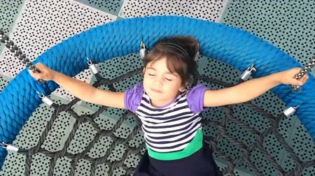 oynamak : Slow motion of a girl on a net swing daydream. Children childhood concept Stok Video