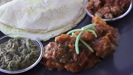 kari : Indian food Chicken Curry served with Dosa with Sambar and Channa Masala. Food background and texture. Dostupné videozáznamy
