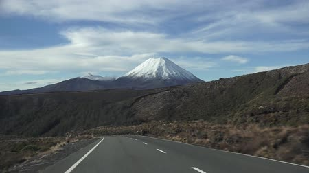 nzl : Snow landscape of Mount Ngauruhoe in Tongariro National Park, It was used as a stand-in for the fictional Mount Doom in Peter Jacksons The Lord of the Rings film trilogy. Stock Footage