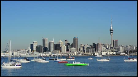 nzl : Auckland downtown skyline.Auckland has been rated one of the worlds top 10 cities to visit by travel bible Lonely Planet.