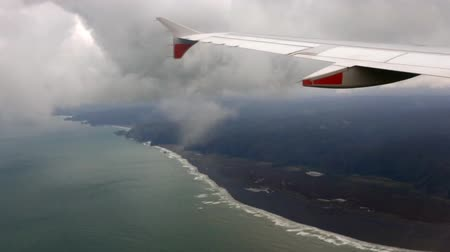 west wing : Aerial landscape and seascape view of New Zealand North Island west coast.