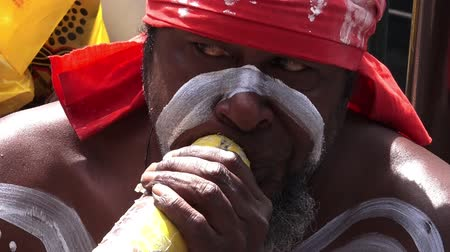 aborigine : Aboriginal Indigenous Australian man play on Didgeridoo, a wind instrument developed by Indigenous Australians over 1,500 years ago in Northern Australia.