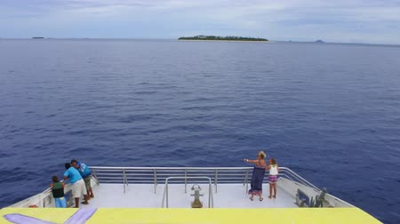 melanesia : Tourists sail on the yellow and fast catamaran, The Yasawa Flyer, Fiji. Its a famouse high speed ferry transfers between the main island on Fiji and Yasawa & Mamanuca Island resorts.