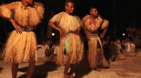 melanesia : Indigenous Fijian men dancing the traditional meke wesi male dance. Real people copy space