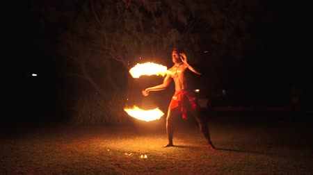 fijian : Indigenous Fijian man during during a fire dance at nigh in Fiji. Real people copy space