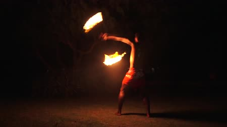 fiji : Indigenous Fijian man during during a fire dance at nigh in Fiji. Real people copy space