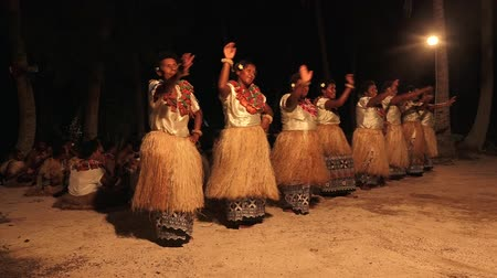 melanesia : Indigenous Fijian women dancing the traditional Meke female dance, the fan dance. Real people copy space