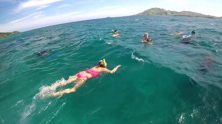 melanesia : People getting ready to snorkel in the Yasawa Islands of Fiji.Fijis annual Visitor Arrival number reached a new high of 792,320 in 2016.