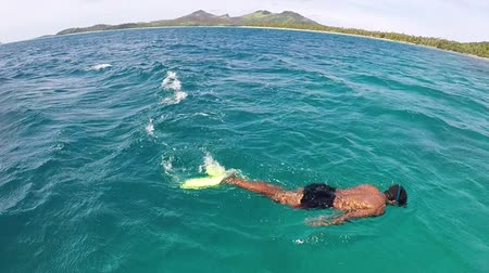 melanesia : Indigenous Fijian man snorkel in the Yasawa Islands of Fiji. Stock Footage