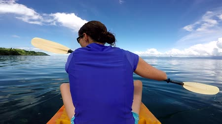 melanesia : Young woman in a kayak, kayaking in a tropical resort on Vanua Levu Island, Fiji. Real people copy space