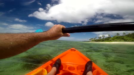 melanesia : Man in a kayak, kayaking along coastline  of a tropical resort in the Coral Coast in Viti Levu Island, Fiji. POV