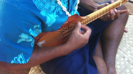 cook islanders : Sound Hands of Polynesian Pacific islander man sing and plays Music with Ukulele guitar.