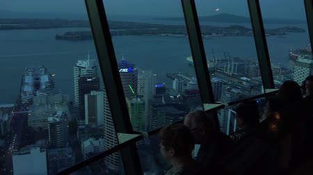 nzl : Visitors at the Sky Tower observation deck in Auckland New Zealand.The sky tower is 328 metres (1,076ft) tall and it the tallest free-standing structure in the Southern Hemisphere.