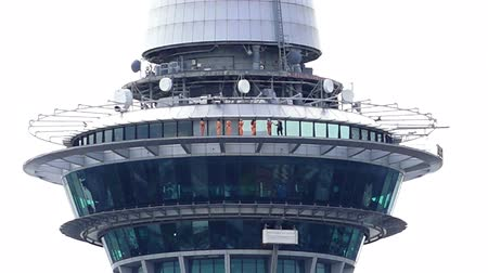 nzl : People skywalk on Auckland sky tower building. Skywalk is one of New Zealands most thrilling tourist attractions in Auckland, New Zealand. Stock Footage