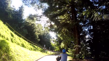 luge : Slow motion of a family ride on Skyline Rotorua Luge. Its a gravity fun ride. Invented in New Zealand in 1985, and having hosted over 30 million rides worldwide. Stock Footage