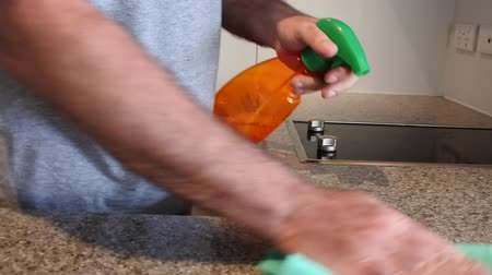 obsessive : Hands of a man cleans and wipes kitchen counter surface with detergent. Hygiene concept. Copy space.