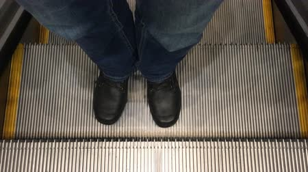 yolları : POV (personal point of view) of a man going up on a moving escalator