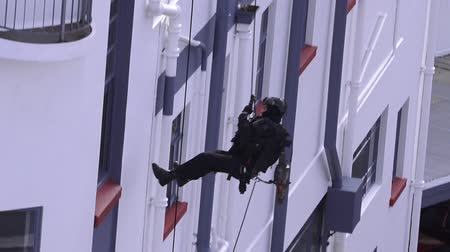 counterterrorism : One unrecognizable Counter-terrorism police officer abseiling a building during an exercise. Stock Footage