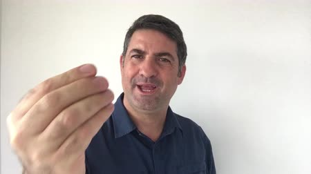 expressed : Italian man demonstrate Approved sign of Italian hand gestures. Body language and facial expression communication concept. Real people. copy space Stock Footage