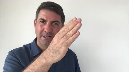 expressed : Italian man demonstrate Are you out of your mind sign of Italian hand gestures. Body language and facial expression communication concept. Real people. copy space Stock Footage