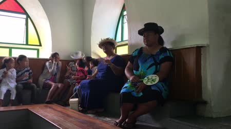 ck : Cook Islanders pray at CICC church.94% of Cook Islanders (14,974) associated themselves with a faith.The Cook Islands Christian Church (CICC) dominant with 49% (7,356) members. Stock Footage