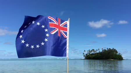 cook islanders : Cook Islands Ensign against  islet, in Muri lagoon. Pacific Island travel holiday vacation concept Stock Footage