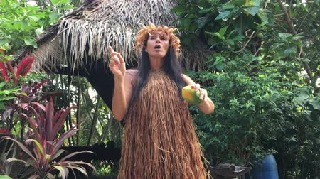 mashing : Mature Cook Islander woman explains about traditionl herbs for herbal medicine in Rarotonga Cook Islands.