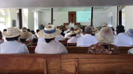 white cloths : Cook Islanders pray at CICC church. 94% of Cook Islanders associated themselves with a faith.The Cook Islands Christian Church (CICC) dominant with 49% (7,356) members Stock Footage