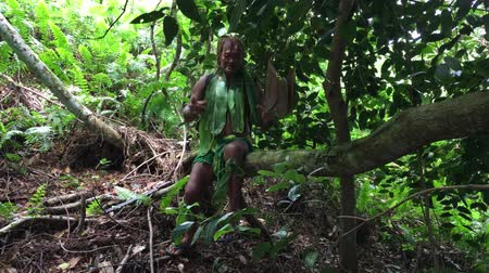 cook islanders : Cook Islander man tour guide on Eco tourism tour in a rain forest in Rarotonga Cook Islands