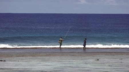 cook islanders : Cook Islander fishermen fishing in Rarotonga reef.Cook islands have the worlds largest ocean preserves (Marae Moana) an exclusive Economic Zone of about 700,000 square miles of sea.