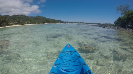 kayak : POV (point of view ) of a person Kayaking Muri Lagoon Rarotonga Cook Islands
