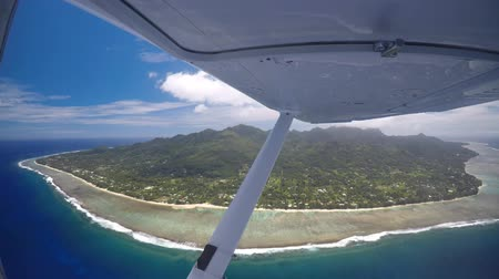 avarua : Aerial view of Rarotonga Island Cook Islands as view on a scenic flight from a small plane Stock Footage