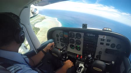 cook islanders : Air Rarotonga pilot fly Cessna 172 Skyhawk on a scenic flight above Rarotonga Island the largest of the Cook Islands, a nation of 15 islands in the central South Pacific. Stock Footage