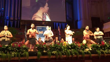 ensign : Maori culture show during New Zealand Citizenship Ceremony in Auckland Town Hall. The number of citizens wanting to move to New Zealand from all over the world has increased considerably from 41K in 1979 to 122K in 2015. Stock Footage