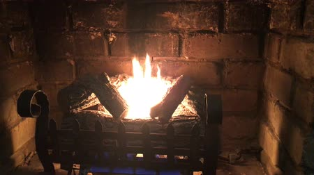 open hearth : Slow motion burning fireplace and wood burning at home on a cold winter day. Stock Footage