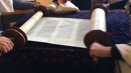 tallit : Jewish men rolling a Torah scroll in synagogue on the seventh and last day of the Jewish holiday festival of Sukkoth (Hoshana Rabbah).