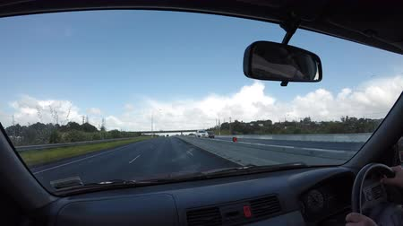 dividindo : Car driver point of view looking at Highway 01 in Auckland in the North Island of New Zealand Stock Footage