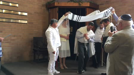 Jewish bridegroom breaks glass in Orthodox Jewish wedding ceremony in a synagogue.Jewish wedding is a wedding ceremony that follows Jewish laws and traditions