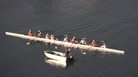Aerial view of Australian rowers in a coxed eight (8+), a sweep rowing boat, In Surfers Paradise Gold Coast, Queensland Australia. Стоковые видеозаписи