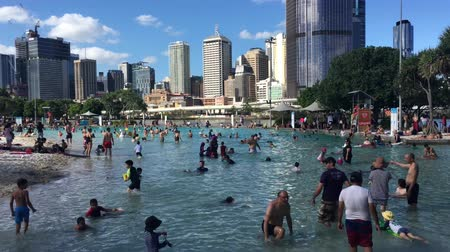 :People swimming in streets beach public swimming pool and parklands in Brisbane city, Queensland, Australia