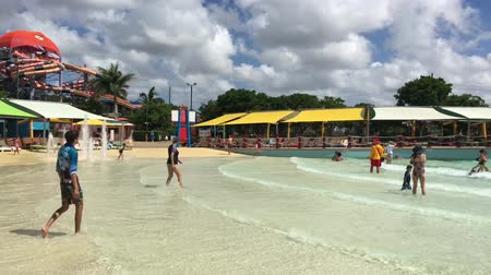 People in WhiteWaterWorld wave pool.The park ranked as one of the worlds most water efficient parks for its sustainable water management and environmentally friendly technology