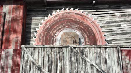 A giant rusty rotating mining saw blade Стоковые видеозаписи