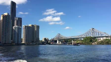 Ferry boats sail under The Story Bridge.Its the longest cantilever bridge in Australia, spanning the Brisbane River in Brisbane Queensland, Australia.