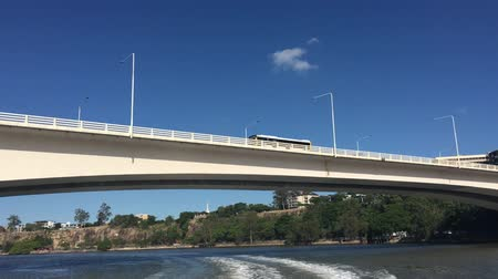 Ferry sailing under Captain Cook Bridge in Brisbane Queensland Australia Стоковые видеозаписи